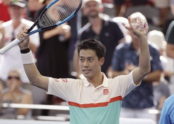 Kei Nishikori waves at the crowd after he won his semifinal match against Jeremy Chardy at the Brisbane International tennis tournament