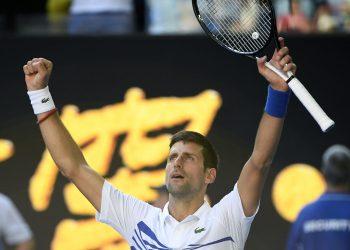 Novak Djokovic celebrates after defeating Denis Shapovalov at the Rod Laver Arena in Melbourne, Saturday