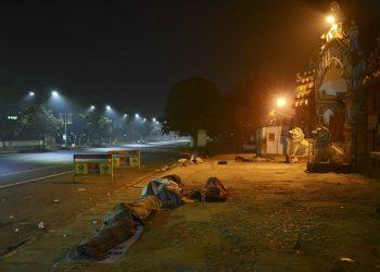 people sleeping on road
