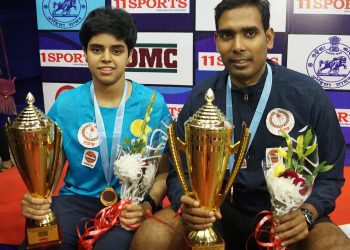 Archana Kamath (L) and Sharath Kamal pose with their trophies and medals at Cuttack, Wednesday