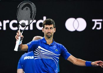 Top seed Novak Djokovic acknowledges the crowd after the conclusion of his quarterfinal match against Kei Nishikori in Melbourne, Wednesday