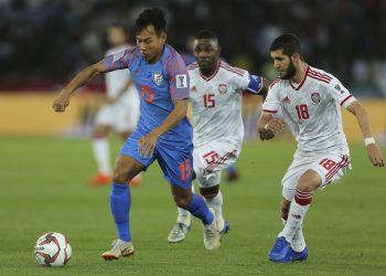 India's Udanta Singh (in Blue) tries to control the ball as two UAE defenders chase him during the AFC Asian Cup game at Abu Dhabi, Thursday night