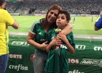 Silvia Grecco and her son Nickollas during a Palmeiras match