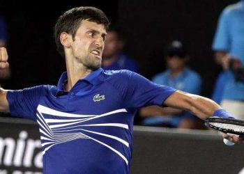 Serbia's Novak Djokovic celebrates after winning a point against Mitchell Krueger. (AP)