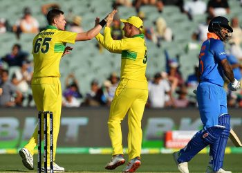 Australians celebrate after the dismissal of Shikhar Dhawan
