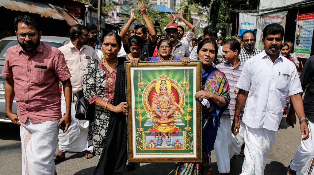 """Protesters hold a portrait of Hindu deity """"Ayappa"""" as they take part in a rally called by various Hindu organisations after two women entered the Sabarimala temple, in Kochi, India, January 2, 2019. REUTERS/Sivaram V"""