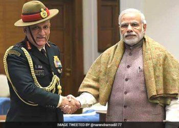 Prime Minister Narendra Modi and Army Chief Gen. Bipin Rawat (L)