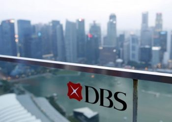 A DBS logo in pictured in the backdrop of the central business district in Singapore (Reuters)