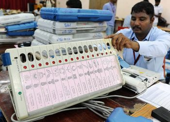 Polling officials pasting candidates list along with photos and party symbols in Electronic Voting Machines(EVM) at distribution centre at NKT National Girls Higher Secondary School in Chennai for Tamil Nadu Assembly elections.10-05-2016 Photo B A Raju