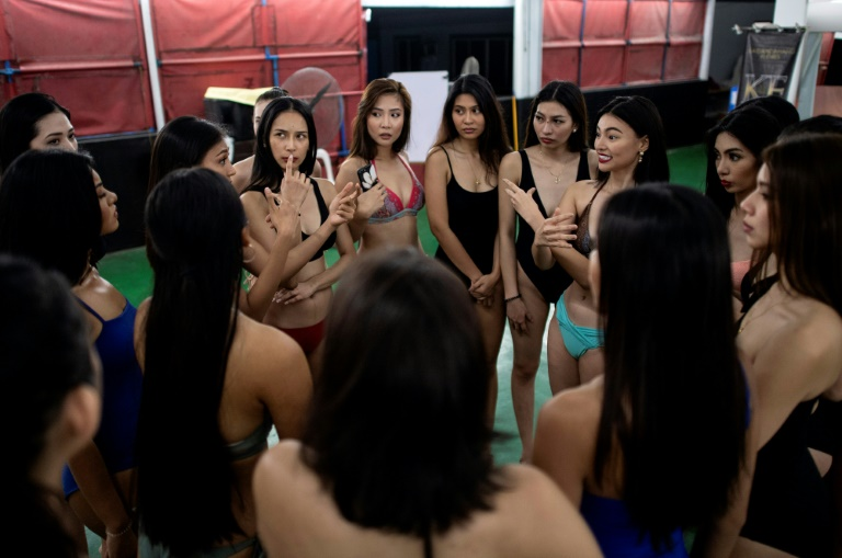 Some 200 hopefuls a year take part in the training at Flores' studio, which include gym workouts, make-up lessons, and duck walk drills (AFP)