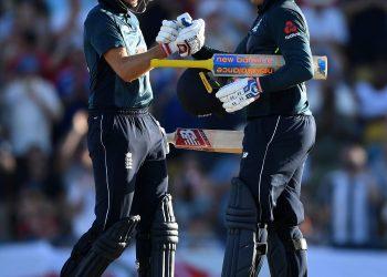 Joe Root (L) congratulates Jason Roy on his century against West Indies in Bridgetown, Wednesday