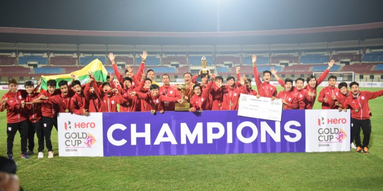 Triumphant Myanmar players pose with the winners' trophy at the Kalinga Stadium in Bhubaneswar, Friday