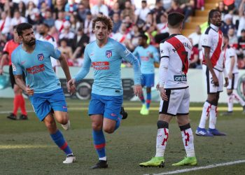 Antoine Griezmann (centre) celebrates after scoring against Rayo Vallecano as Diego Costa (left) runs to join him