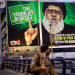 """A billboard shows Hezbollah militant leader Hassan Nasrallah above a major highway in Tel Aviv on Sunday. Above Nasrallah's finger reads the caption: """"I don't recycle bottles."""" and beneath him, the poster says: """"Nasrallah has been stuck in a bunker for 12 years. What is your excuse?"""" (AP)"""
