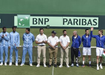The Indian and Italian teams along with match officials pose before the start of the Davis Cup tie in Kolkata