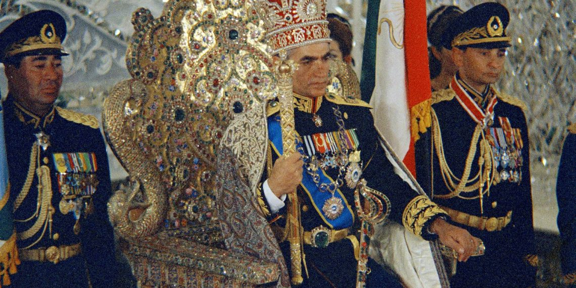 FILE - In this October 1967 file photo, Shah Mohammad Reza Pahlavi sits on the Peacock Throne in Tehran, Iran. Forty years ago, Iran's ruling shah left his nation for the last time and an Islamic Revolution overthrew the vestiges of his caretaker government. The effects of the 1979 revolution, including the takeover of the U.S. Embassy in Tehran and ensuing hostage crisis, reverberate through decades of tense relations between Iran and America. (AP)