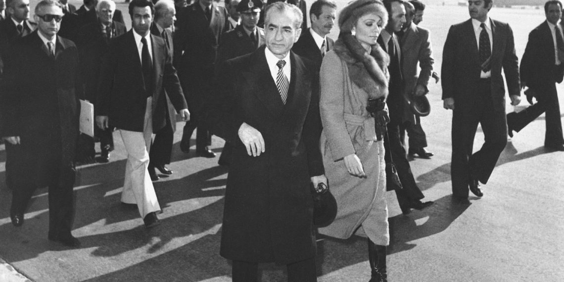 FILE - In this Jan. 16, 1979 file photo, Shah Mohammad Reza Pahlavi and Empress Farah walk on the tarmac at Mehrabad Airport in Tehran, Iran, to board a plane to leave the country. Forty years ago, Iran's ruling shah left his nation for the last time and an Islamic Revolution overthrew the vestiges of his caretaker government. The effects of the 1979 revolution, including the takeover of the U.S. Embassy in Tehran and ensuing hostage crisis, reverberate through decades of tense relations between Iran and America. (AP)