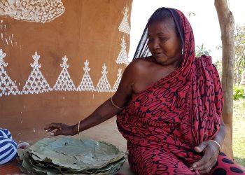 A woman with Sal leaf plates at Dengajhari village in Nayagarh district
