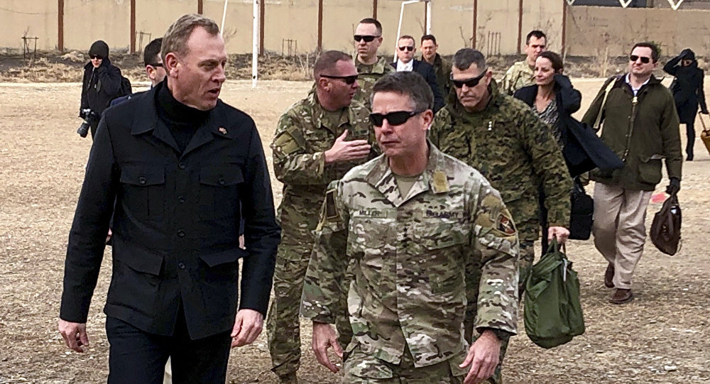 Acting Defense Secretary Pat Shanahan, left, arrives in Kabul, Afghanistan, Monday morning, Feb. 11, 2019, to consult with Army Gen. Scott Miller, right, commander of U.S. and coalition forces, and senior Afghan government leaders. The unannounced visit is the first for the acting secretary of defense, Pat Shanahan. He previously was the No. 2 official under Jim Mattis, who resigned as defense chief in December. (AP)