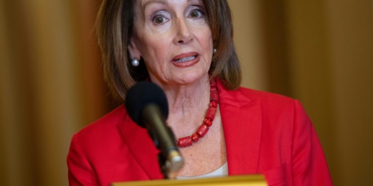 """US Speaker of the House Nancy Pelosi (pictured February 13, 2019) and Senate Minority Leader Chuck Schumer said that declaring a national emergency would be """"a lawless act, a gross abuse of the power of the presidency"""" (AFP)"""