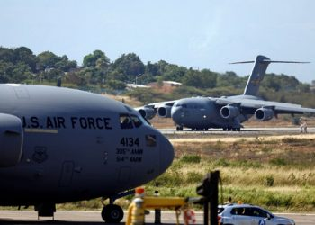 A second US Air Force plane carrying humanitarian aid for Venezuela taxis after landing at Camilo (AP)