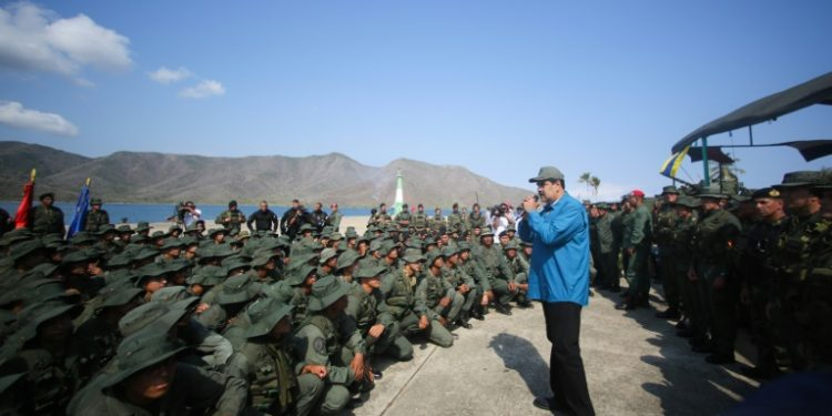 Venezuela's President Nicolas Maduro speaks to troops at a naval base, a day after a top general sided with the opposition