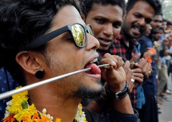 A Hindu devotee with his tongue pierced with a metal skewer takes part in a procession during the Thaipusam festival on the outskirts of Kochi, India, January 21, 2019. (REUTERS/Sivaram V)