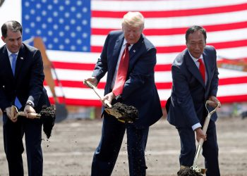 U.S. President Donald Trump, center, takes part in a groundbreaking with Wisconsin Gov. Scott Walker, left, and Foxconn Chairman Terry Gou at Foxconn's new site in Mount Pleasant, Wisconsin, on June 28. (Reuters)