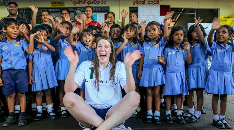 Seenigama: In this October 6, 2015 photo, Laureus Ambassador and Olympic gold medalist Missy Franklin poses for a picture with children at an event in Seenegama, Sri Lanka. (Laureus/PTI Photo) (PTI2_19_2019_000041B)