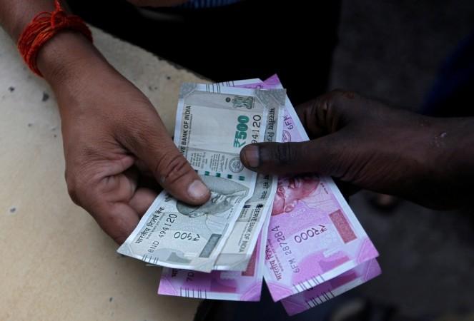 Rupee slips marginally in opening deals