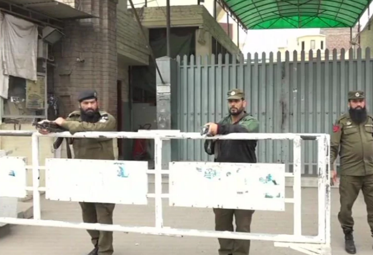 Armed guards outside JuD headquarters