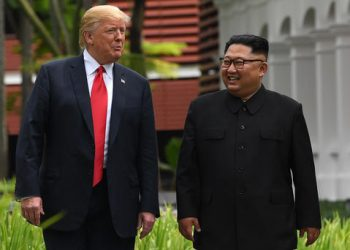 North Korea's leader Kim Jong Un (R) walks with US President Donald Trump (L) during a break in talks at their historic US-North Korea summit, at the Capella Hotel on Sentosa island in Singapore on June 12, 2018. AFP PHOTO / SAUL LOEBSAUL LOEB/AFP/Getty Images