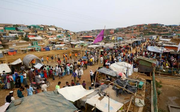 Rohingya refugees gather at a market inside a refugee camp near Cox Bazaar in Bangladesh