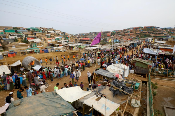 Rohingya refugees gather at a market inside a refugee camp near Cox Bazaar in Bangladesh