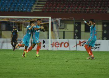Amarjit Singh celebrates (C) with teammates after scoring the opener against Kerala Blasters at the Kalinga Stadium, Friday
