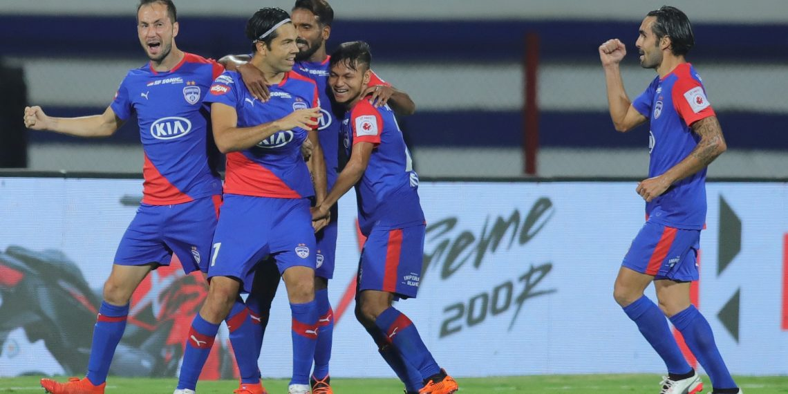 Bengaluru FC players celebrate after scoring the first goal against NEUFC, Monday