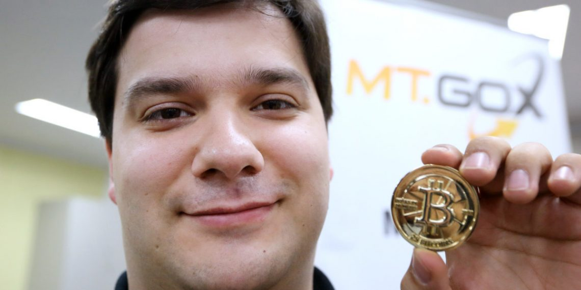 Mark Karpeles, chief executive officer of Tibanne Co., poses for a photograph with a bitcoin in the office operating the Mt.Gox K.K. bitcoin exchange in Tokyo, Japan, on Thursday, April 25, 2013. Bitcoin digital currency, which carries the unofficial ticker symbol of BTC, was unveiled in 2009 by an unidentified programmer, or group of programmers, under the name of Satoshi Nakamoto. Supply is capped at 21 million Bitcoins and managed by a software algorithm embedded into the digital currency?s design, rather than a monetary authority such as a central bank. (Photographer: Tomohiro Ohsumi/Bloomberg via Getty Images/AFP)