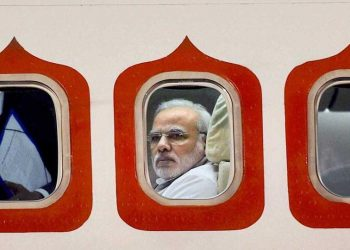 A 2014 file photo of Prime Minister Narendra Modi in his special aircraft as he arrived at the Brasilia International Airport in Brazil. (PTI)
