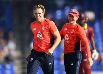 David Willey (L), along with England skipper Eoin Morgan, is all smiles after dismissing a Windies batsman, Sunday