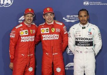 Charles Leclerc (C) celebrates on the podium after qualifying in pole position alongside Sebastian Vettel (L) and Lewis Hamilton, Saturday