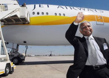 Jet Airways founder Naresh Goyal waves in front of a taxied Aircraft. (AFP)