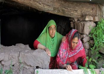 women come out as they clean an underground bunker in balkote URI  near the Line of control. The people living along the LOC are living in constant fear due to the hostilities between india pakistan. Express Photo by Shuaib Masoodi. 04.06.2017. *** Local Caption *** women come out as they clean an underground bunker in balkote URI  near the Line of control. The people living along the LOC are living in constant fear due to the hostilities between india pakistan. Express Photo by Shuaib Masoodi. 04.06.2017.
