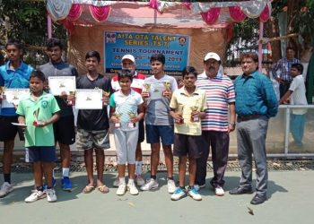 Winners and runners-up in various categories of AITA OTA TS7 tennis tournament pose with their trophies and certificates along with guests in Bhubaneswar, Friday