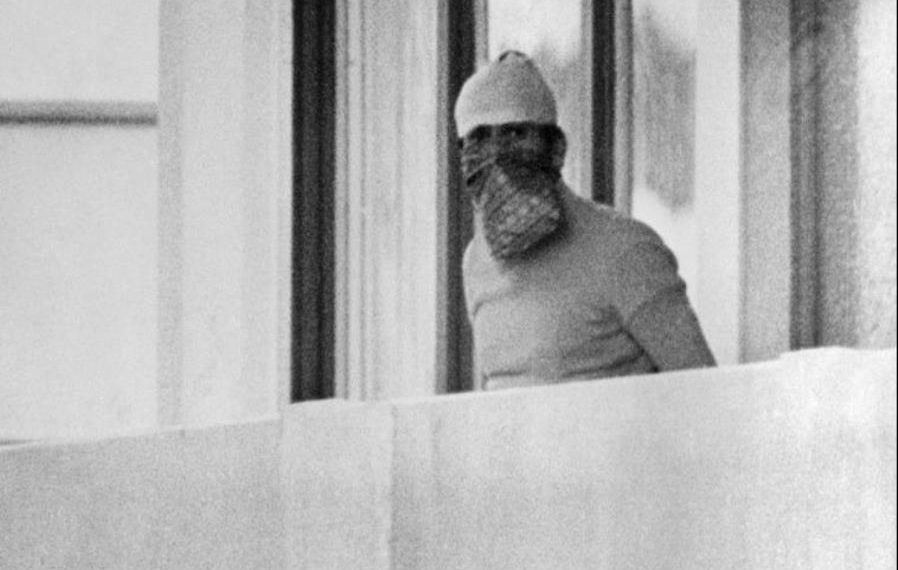 A member of the Palestinian terrorist group Black September appears on the balcony of the Israeli house at the Munich Olympic village September 5, 1972. (Image: AP)