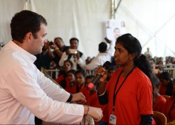 Rahul Gandhi interacts with a delegate attending the convention in Jeypore, Friday Photo@Congress Twitter
