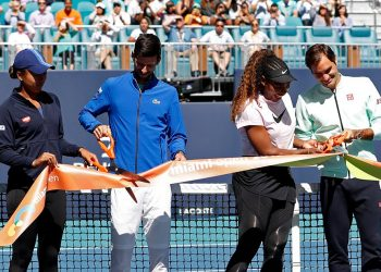 (L-R) Naomi Osaka of Japan, Novak Djokovic of Serbia, Serena Williams of the United States, and Roger Federer of Switzerland participate in a ribbon-cutting ceremony on new stadium court at Hard Rock Stadium prior to play in the first round of the Miami Open at Miami Open Tennis Complex. (Reuters)