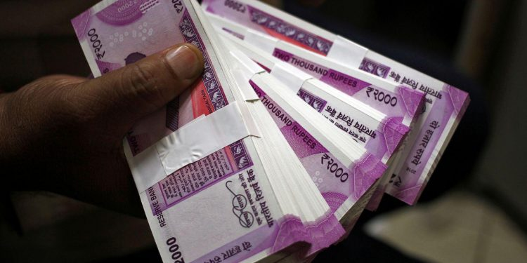 Rupee slips 11 paise against dollar in early trade
