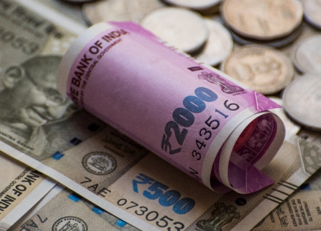 Rupee rises 9 paise to 70.25 vs USD in early trade