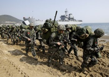 FILE - In this March 30, 2015, file photo, South Korean Marines march after landing on the beach during the U.S.-South Korea joint landing military exercises as a part of the annual joint military exercise Foal Eagle between South Korea and the United States in Pohang, South Korea. South Korea and the U.S. say they've decided to end their springtime military drills to back diplomacy with North Korea. (AP)