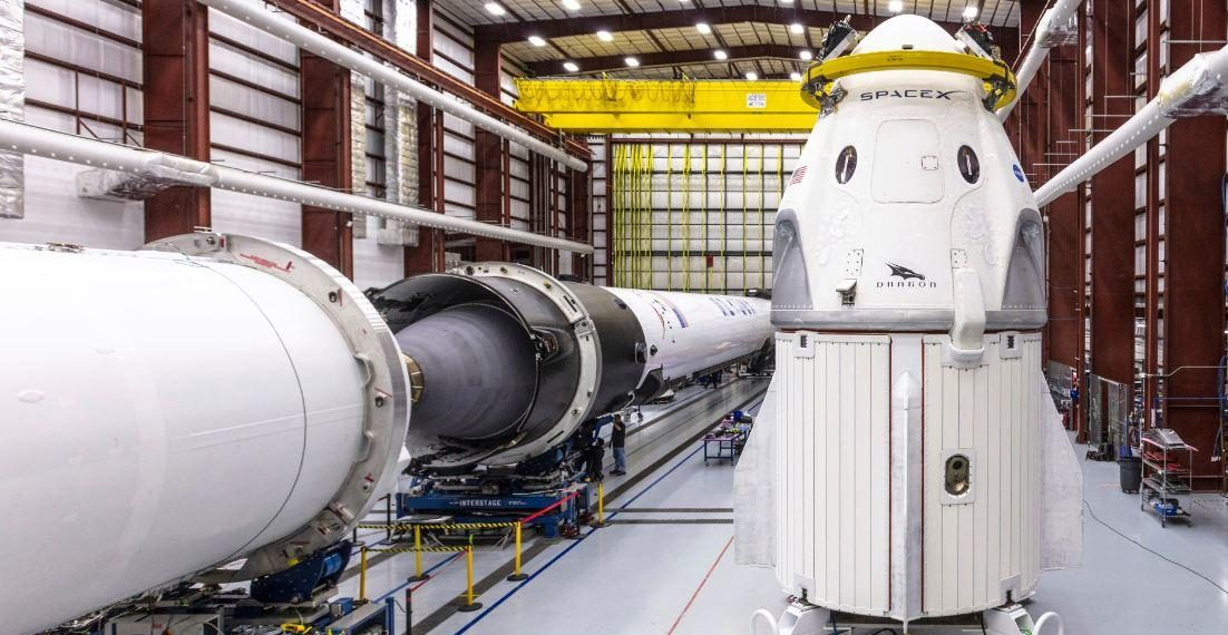 In this Dec. 18, 2018 photo provided by SpaceX, SpaceX's Crew Dragon spacecraft and Falcon 9 rocket are positioned inside the company's hangar. (AP)